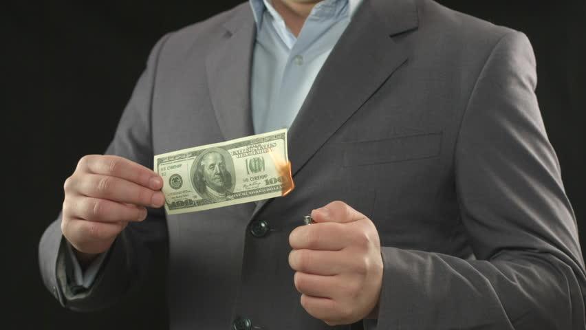 One hundred dollar bill on fire. Going bankrupt, losing money | Shutterstock HD Video #10544177