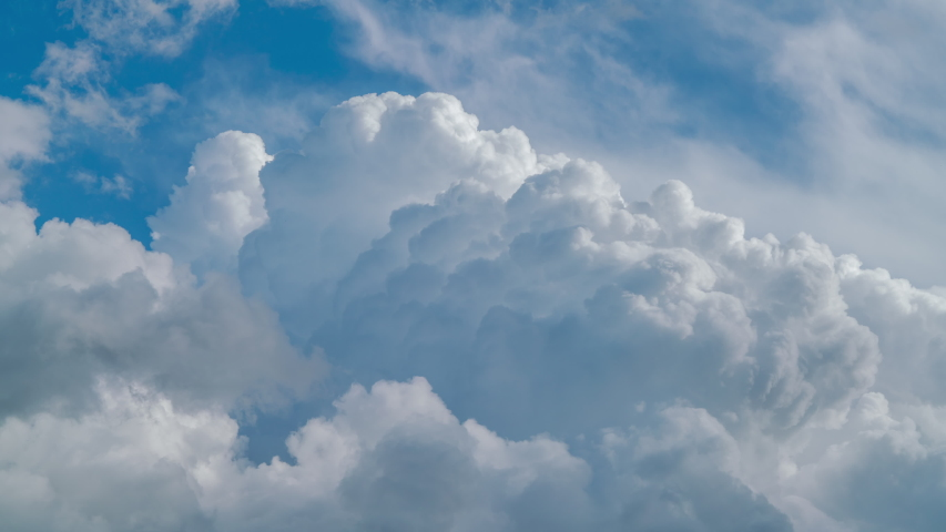 Blue sky white clouds. Puffy fluffy white clouds. Cumulus cloud scape timelapse. Summer blue sky time lapse. Dramatic majestic amazing blue sky. Soft white clouds form. Cloud time lapse background HDR