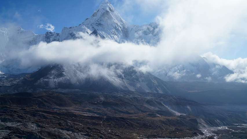 4K Time lapse of clouds moving on background of high snow Ama Dablam peak