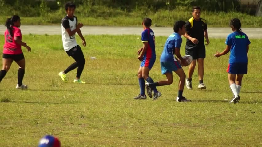 LAGUNA, PHILIPPINES - CIRCA 2014: Rugby Players are rigorously trained for the incoming athletic sports event. Public Event #10544471