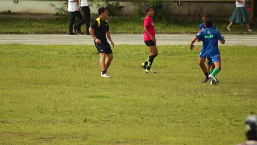 LAGUNA, PHILIPPINES - CIRCA 2014: Rugby Players are rigorously trained for the incoming athletic sports event. Public Event #10544480