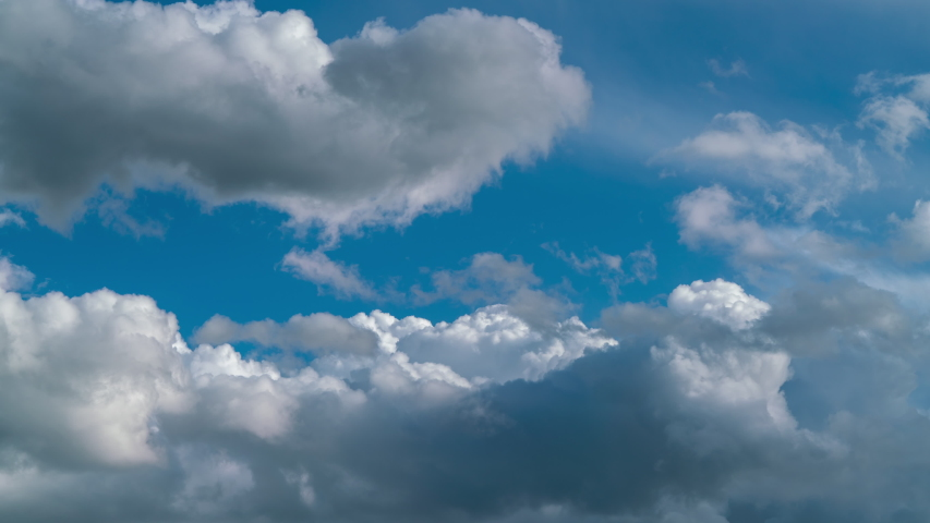 Blue sky white clouds. Puffy fluffy white clouds. Cumulus cloud scape timelapse. Summer blue sky time lapse. Dramatic majestic amazing blue sky. Soft white clouds form. Cloud time lapse background sky