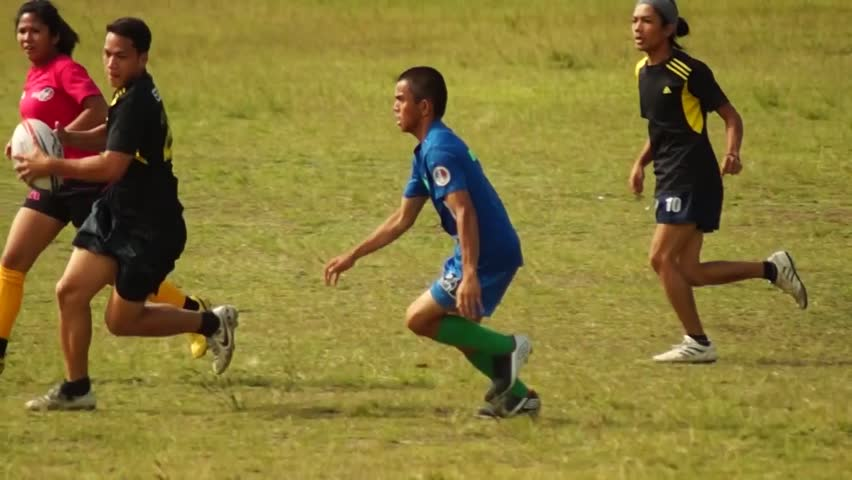 LAGUNA, PHILIPPINES - CIRCA 2014: Rugby Players are rigorously trained for the incoming athletic sports event. Public Event #10544501