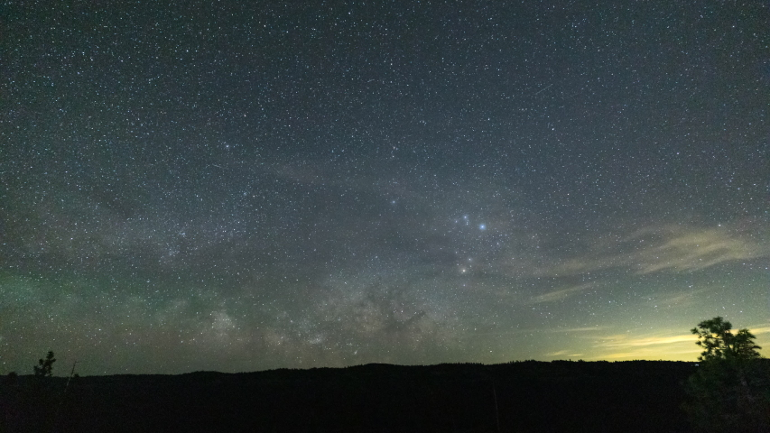 The Milky Way rising over the Sierra Nevada Mountains in northern California on a clear night with Jupiter and Saturn rising just above the horizon, 16:9.    Shutterstock HD Video #1054456898