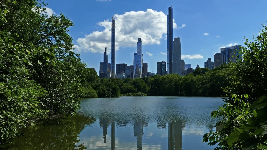 Reflections on the water in the Central Park, New York City   Shutterstock HD Video #1054457768