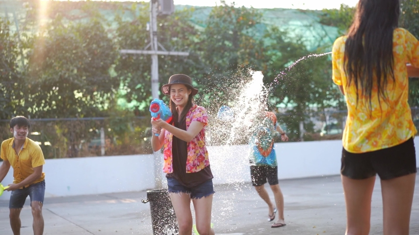 Asian people are using water guns play songkran festival in the summer