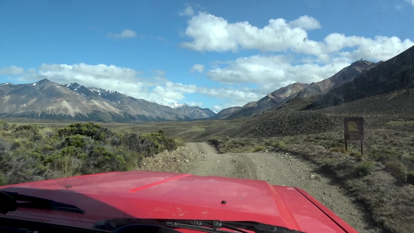 Self Drive Expedition  offroad in a wild patagonia  mountain landscape | Shutterstock HD Video #1054466954