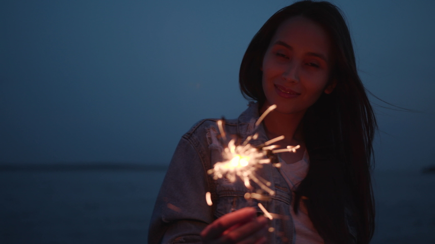 Smile Carefree Millennial Joyful 30s Girl Hang Out on Nature. Real Fun with Vibrant Color Glow Burn Sparklers in Holding Hand. Casual Happy Women Waving Funky Sparkler. Bengal Flicker Waving Flash 4k