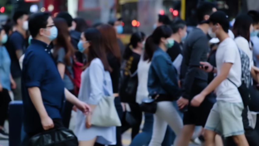 Slow motion of unrecognized people wearing medical face mask in Hong Kong. Coronavirus concept
