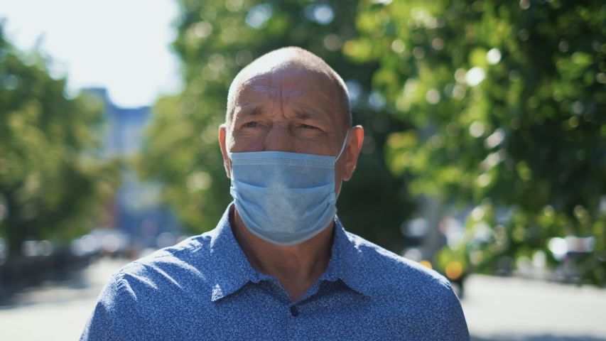 Real old age People Go Walk. Respiratory Mask. Older Senior Man. Pandemic Covid-19. Corona Virus Mers. Retirement pensioner. Elder Aged Human City. Epidemic Coronavirus. Masked olderly Face. Covid 19. Royalty-Free Stock Footage #1054488302