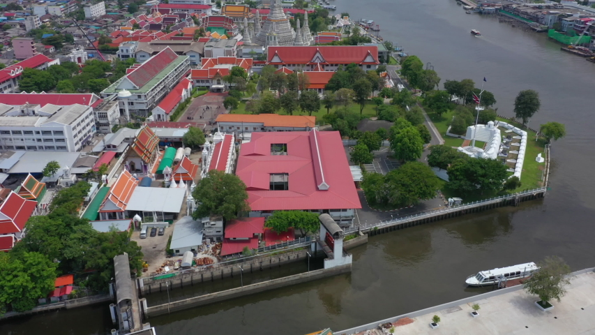 Aerial video of Wat Arun and Bangkok city skyline. Wat Arun is the old temple located near Chaophraya river in Bangkok of Thailand. | Shutterstock HD Video #1054491752