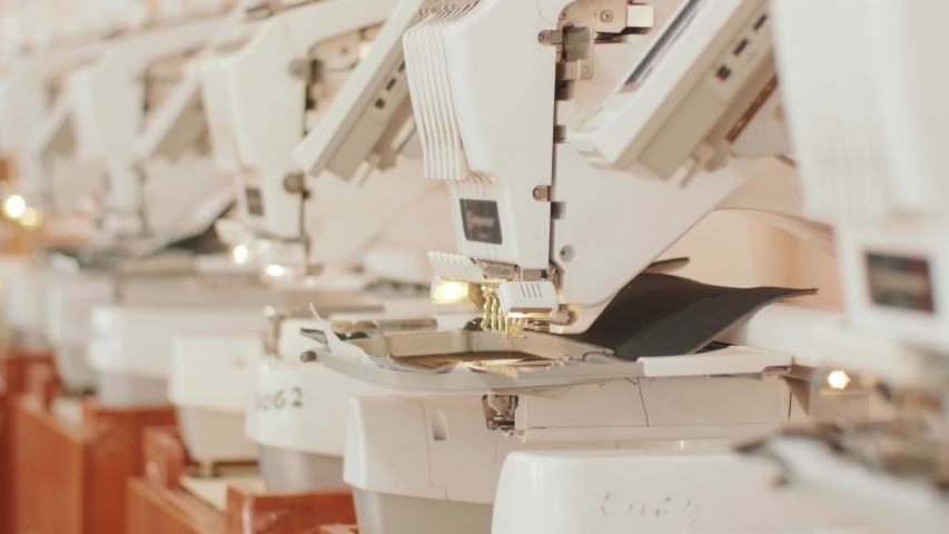 The automatic embroidery machine is working at high speed. | Shutterstock HD Video #1054493048