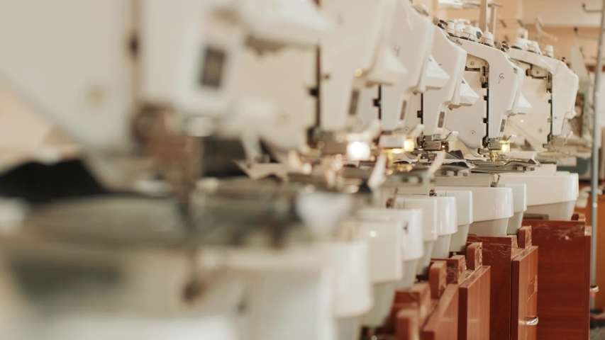 The automatic embroidery machine is working at high speed. | Shutterstock HD Video #1054493051