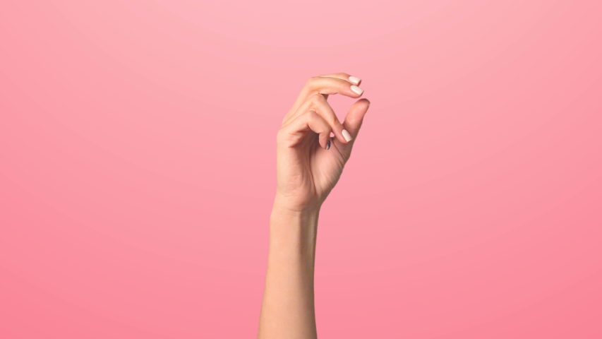 Click your fingers to change the background color. Pink background, a woman's hand rises making a finger click and changes color | Shutterstock HD Video #1054494542