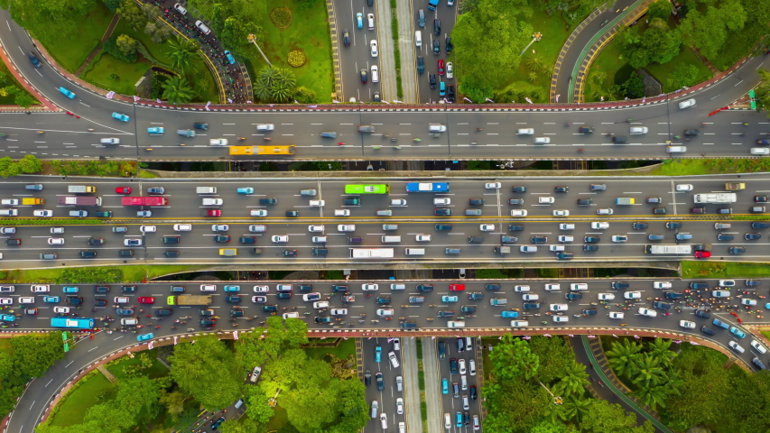 jakarta city center sunny day busy traffic street road junction aerial topdown panorama 4k indonesia Royalty-Free Stock Footage #1054495010