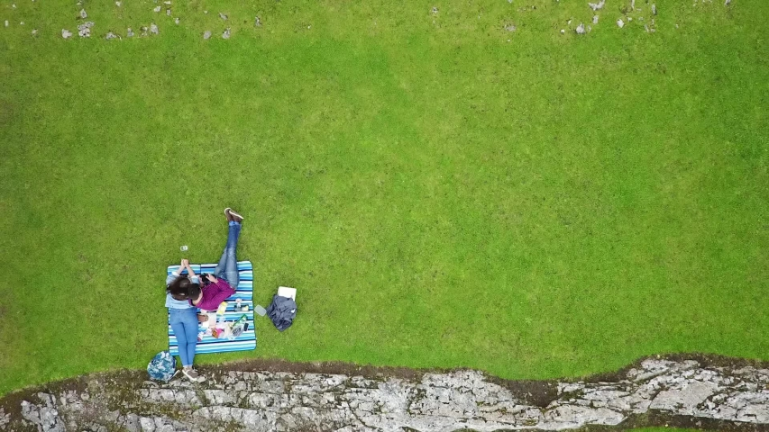 Drone Overhead Aerial shot of Carreg Cennen Castle Wales with couple having picnic | Shutterstock HD Video #1054505042