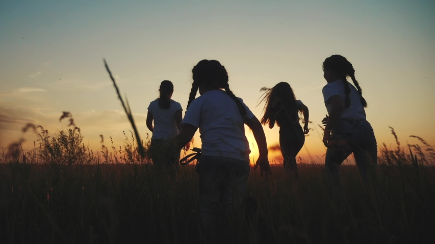 happy family children kid together run in the park at sunset silhouette. people in the park concept mom dad daughter and son joyful run. happy family and little baby child fun summer kid dream concept Royalty-Free Stock Footage #1054505354