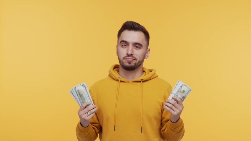 Expressive and happy man with a bunch of money. Person who won jackpot. Lottery and casino concepts. | Shutterstock HD Video #1054508645