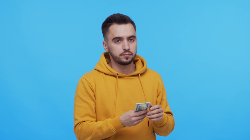 Expressive and happy man with a bunch of money. Person who won jackpot. Lottery and casino concepts. | Shutterstock HD Video #1054508648