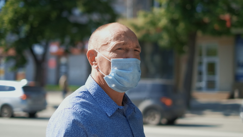 Real old age People Go Walk. Respiratory Mask. Older Senior Man. Pandemic Covid-19. Corona Virus Mers. Retirement pensioner. Elder Aged Human City. Epidemic Coronavirus. Masked olderly Face. Covid 19. Royalty-Free Stock Footage #1054519118
