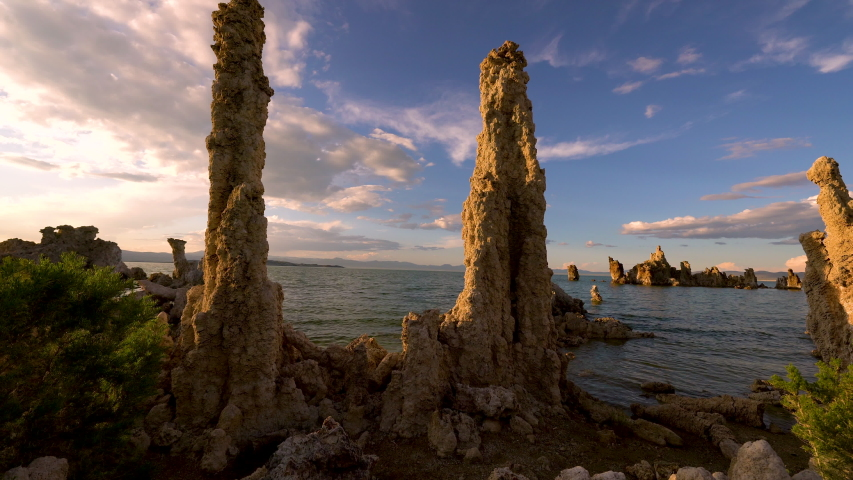 Cinematic tracking shot of sunset sky over tufa formations at Mono Lake, California