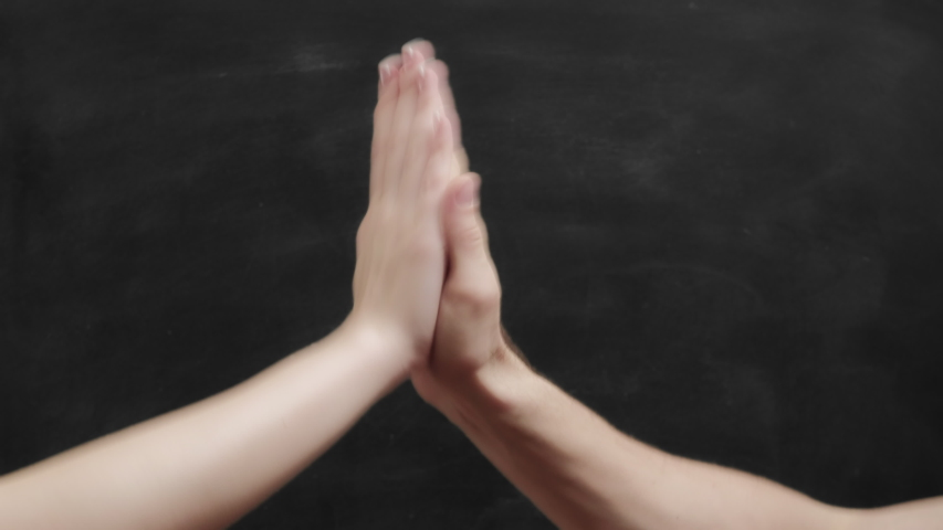 Good job. Man woman hands giving high five over blackboard copy space. Set of 4 gesture templates. Royalty-Free Stock Footage #1054538474