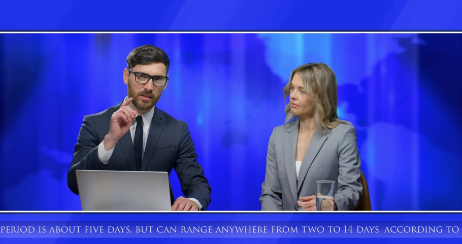 Caucasian male and female TV news presenters sitting at table with laptop computer and talking on air in evening. Man and woman co-workers journalists on television. Blue background with map world.   Shutterstock HD Video #1054549019