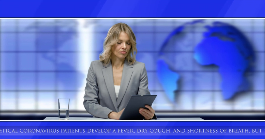 Caucasian woman newsreader reading news about coronavirus from folder while sitting in studio at table. Blue background with world map. Female journalist broadcasting on air in evening. | Shutterstock HD Video #1054549043