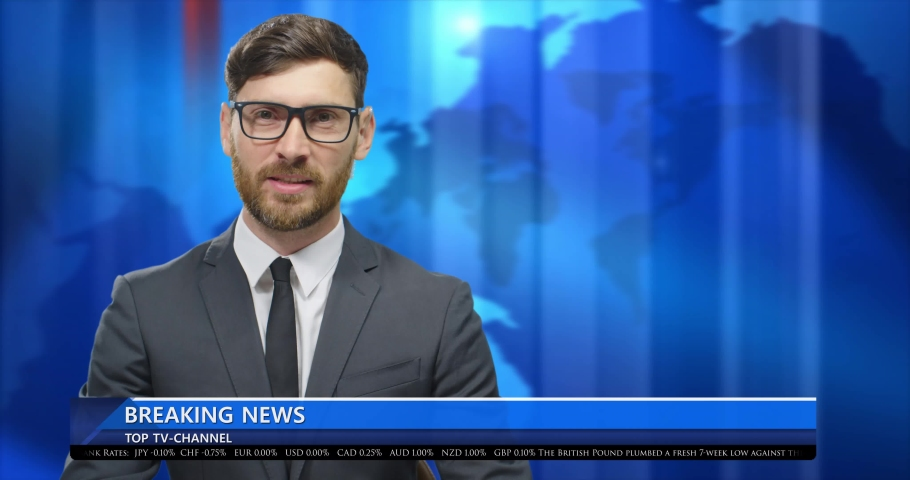 Caucasian handsome young man journalist in glasses, suit and tie presenting breaking news in live at TV channel. Male presenter in studio at blue interactive world map showing regions and talking. | Shutterstock HD Video #1054549064