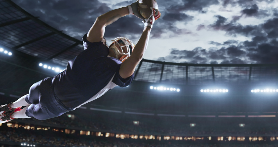American football player in action on a professional stadium. Stadium is made in 3d with animated crowd.