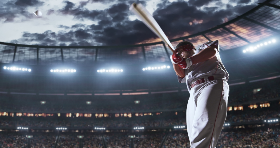 Baseball player in action on the professional stadium. The stadium is made in 3D with animated crowd.