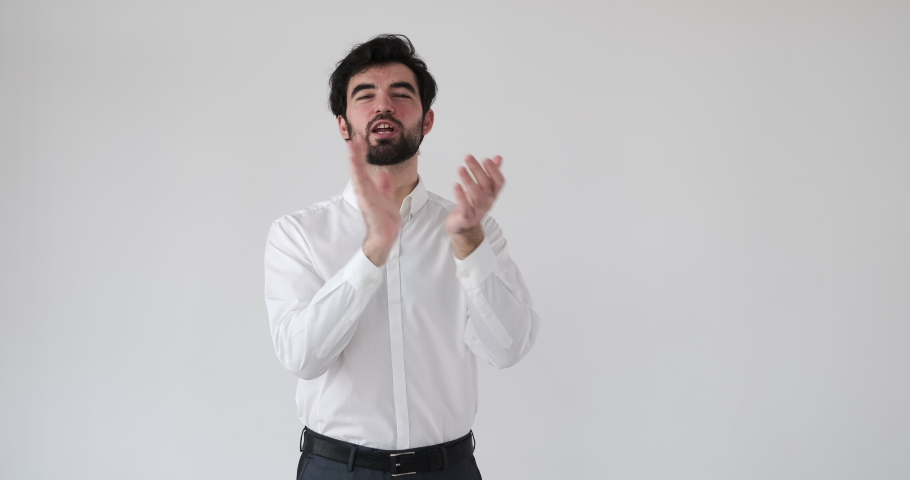 Businessman clapping and giving thumbs up gesture