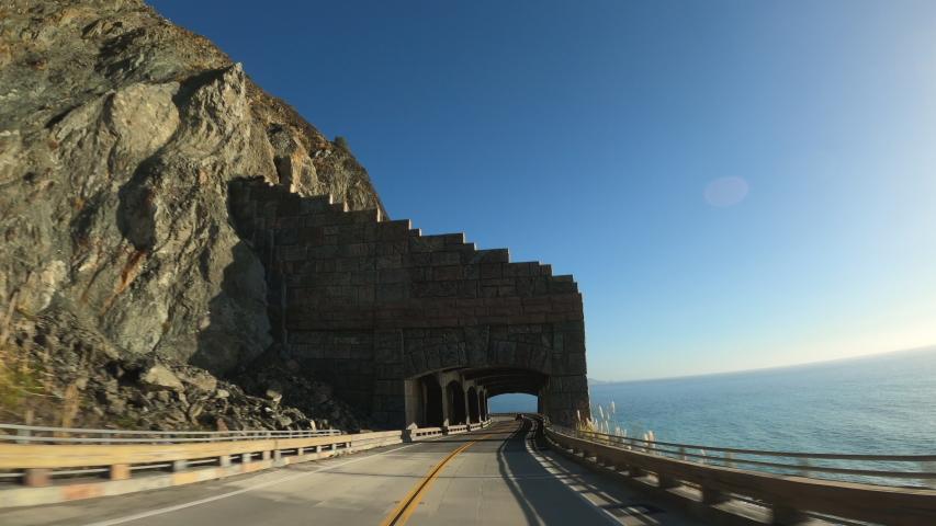 Big Sur California Arch driving inCabrillo Highway 1 coast road, pov south, tunnel   Shutterstock HD Video #1054577501