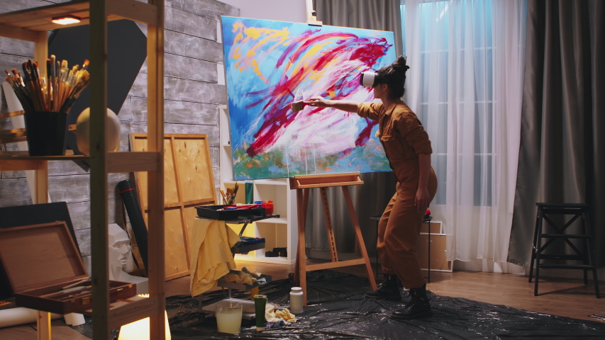 Female painter working on abstract painting in studio. Modern artwork paint on canvas, creative, contemporary and successful fine art artist drawing masterpiece   Shutterstock HD Video #1054578119
