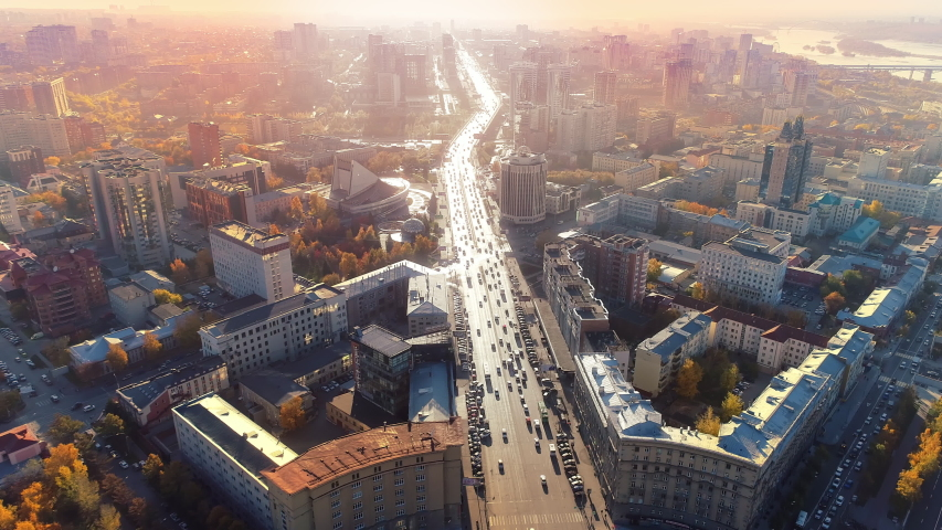 Road in the city center at dawn. Epic aerial flight over the morning city. Beautiful view. Early morning sunrise. Colorful autumn trees. Golden hour of sunset. Glory Inspiration. European city center