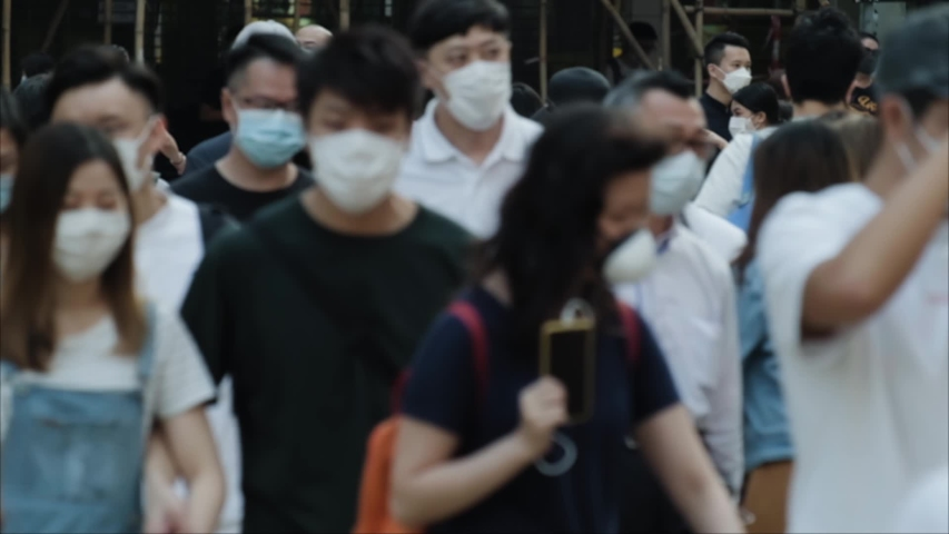 Slow motion of unrecognized people wearing medical face masks in Hong Kong. Coronavirus concept | Shutterstock HD Video #1054581206