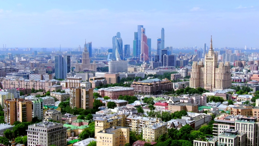 Moscow, Russia. Aerial panoramic view of the downtown, soviet high-rise buildings and Moscow city skyscrapers Drone flying over the amazing cityscape.