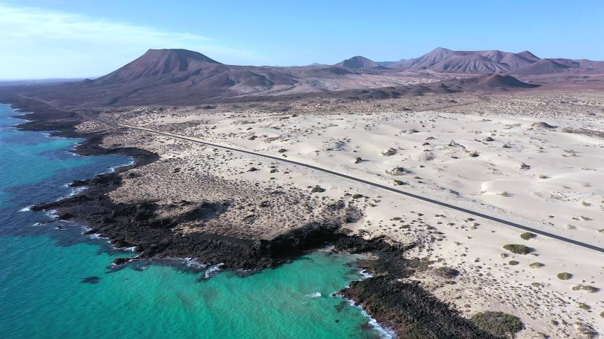 Spain, Canary Islands, Fuerteventura, aerial view of road crossing Corralejo Dunes Natural Park | Shutterstock HD Video #1054603262
