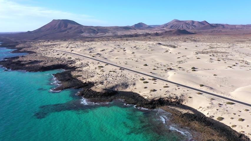 Spain, Canary Islands, Fuerteventura, aerial view of road crossing Corralejo Dunes Natural Park | Shutterstock HD Video #1054603268