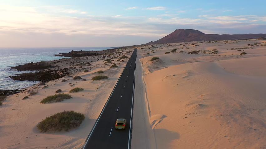 Spain, Canary Islands, Fuerteventura, aerial view of road crossing Corralejo Dunes Natural Park | Shutterstock HD Video #1054603313