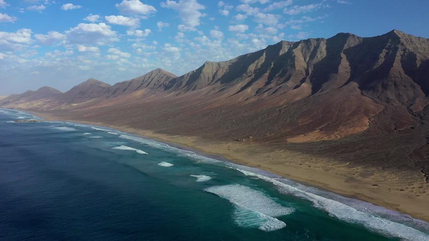 Spain, Canary Islands, Fuerteventura, Parque Natural Jandia, Playa de Cofete and mountain landscape | Shutterstock HD Video #1054603370