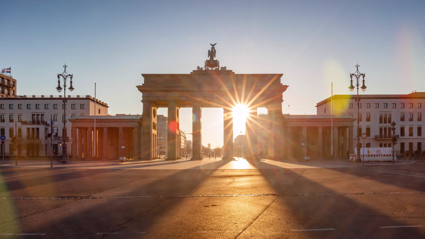 Night to Day Time Lapse of brandenburg gate with morning traffic, Berlin, Germany