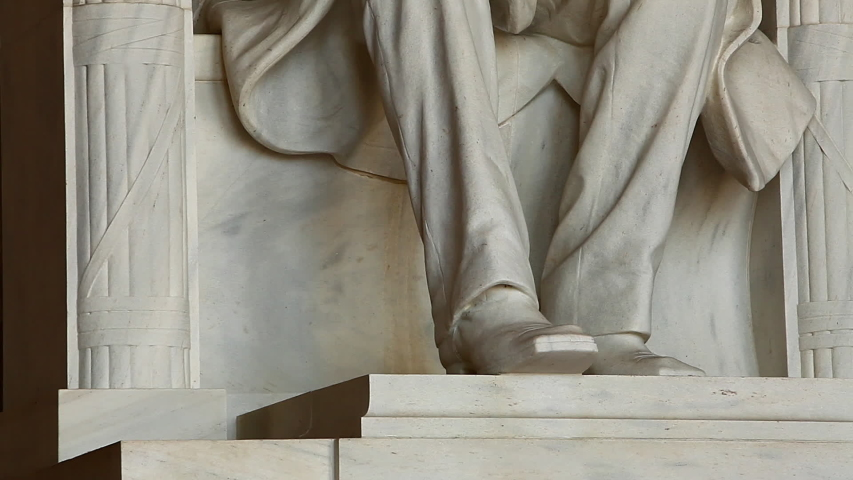 Tilting shot of the Abraham Lincoln statue inside the Lincoln Memorial in Washington DC