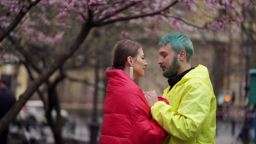 Man and woman take masks off each other and kiss | Shutterstock HD Video #1054614920