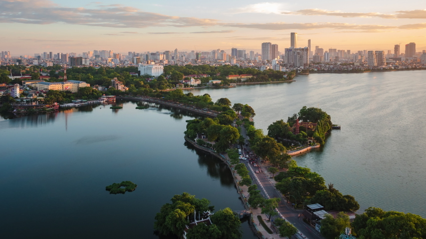 Hanoi, Vietnam, zoom out timelapse view of Hanoi skyline at sunset showing West Lake and Tay Ho District. Royalty-Free Stock Footage #1054618886