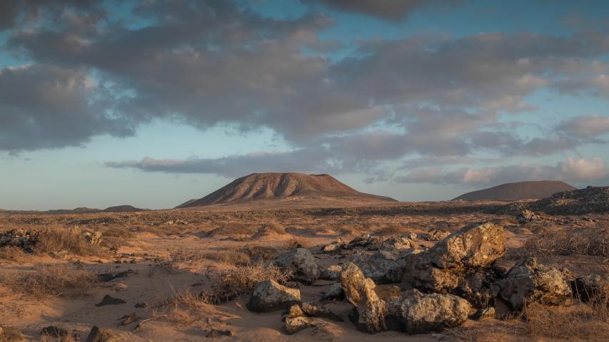 Looping gif video of clouds moving in sky above desert landscape in Fuerteventura, Spain | Shutterstock HD Video #1054623899