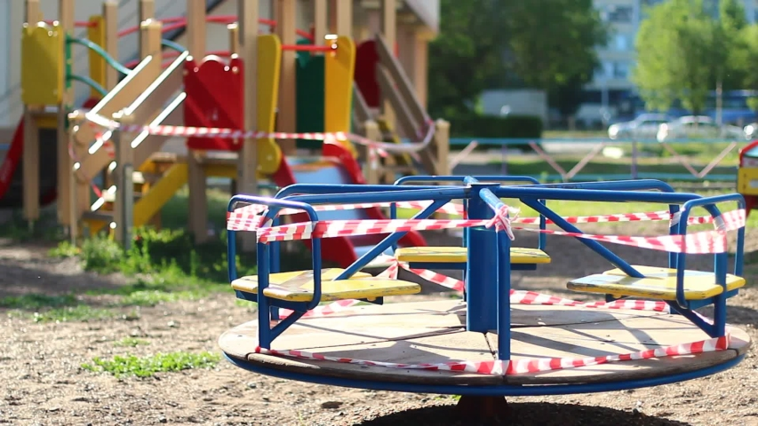 Qurantine on the playground with red ribbons | Shutterstock HD Video #1054630166