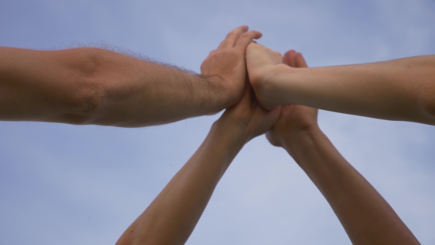 Group of successful people raise hands up. Teamwork. Group of businessmen helping hand. Successful business. Teamwork concept. Team business. Helping hand in business. Businessmen raise hands up Royalty-Free Stock Footage #1054632680