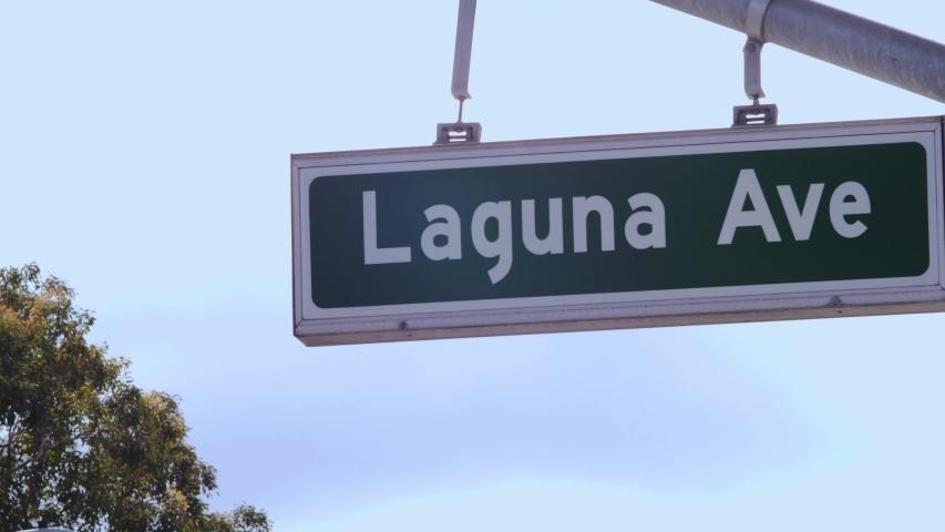 Laguna Avenue Street Sign Location Beach Town Southern California Sky | Shutterstock HD Video #1054639202