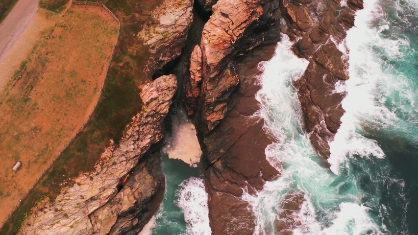Aerial view over the steep cliffs of the Irish west coast. Drone footage   Shutterstock HD Video #1054642070